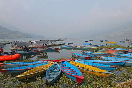 Colorful boats on the lake Phewa in Pokhara, Nepal photo
