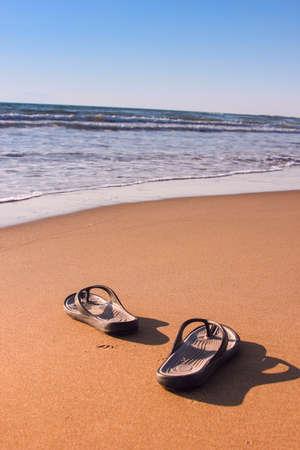 sandles: Flipflops on a sandy beach  Summer vacation concept