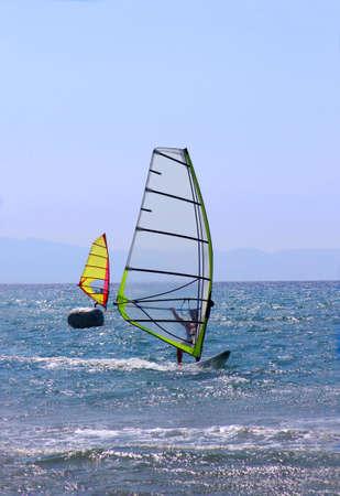 windsurfers: Windsurfers competing on a sunny day Stock Photo