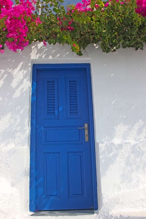 An entrance to a traditional greek house in Santorini island photo