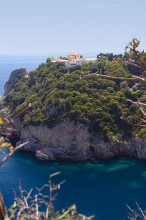 Cliffs over the sea with a monastery  Corfu, Greece photo
