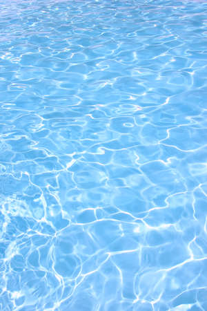 rippling: Rippling water in a pool  Bright blue water background