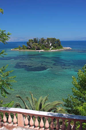 A small island in Mediterranean sea  Pontikonisi, Corfu, Greece photo
