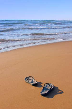 flipflops: Flipflops on a sandy beach  Summer vacation concept Stock Photo