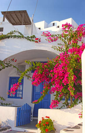 An entrance to a traditional greek house in Santorini photo