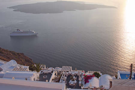 View at the volcanic caldera with a big cruise ship in Santorini island, Greece photo
