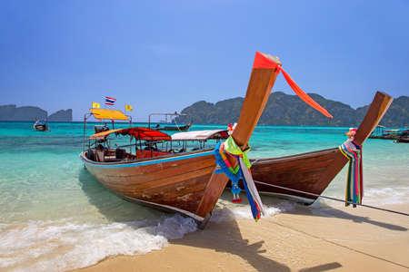 Longtail boats landing at Railay bay, Krabi province, Thailand