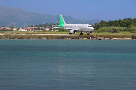 Aircraft landing at a mediterranean island  The airport in Corfu, Greece photo