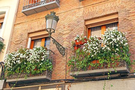 Flowers on a house facade, Spain photo