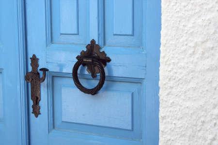 doorhandle: Old wooden door with doorhandle. Traditional greek house