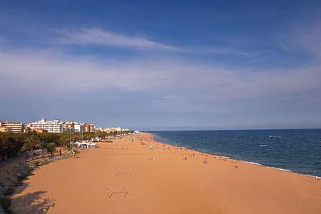 holydays: Sandy beach in a small european town. Mediterranean summer holydays