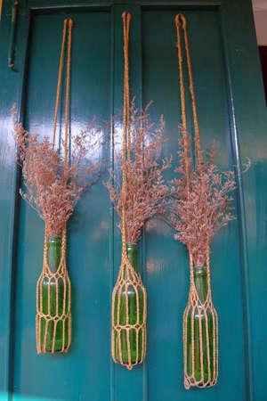 Decorative bottles hanging on a door 免版税图像