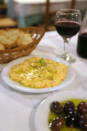 Traditional greek dinner. Tyrokafteri, a dish of mushed salty cheese and spices