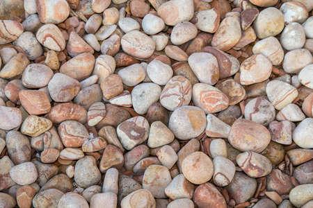 Brown pebbles background. Full frame Stock Photo