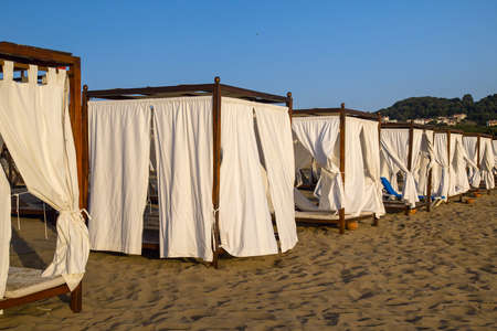 canopies: Row of beach canopies at a luxury resort