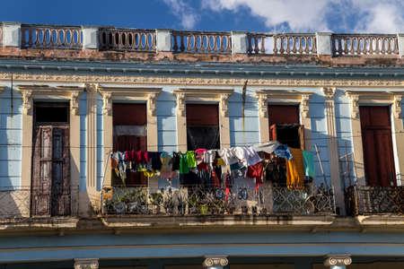 Laundry drying on a balcony in Old Havana street Stock Photo