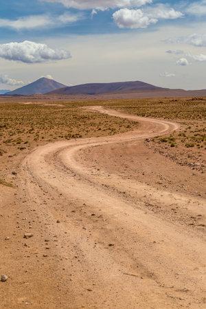 Winding dirt road in a high desert. Altiplano, Bolivia