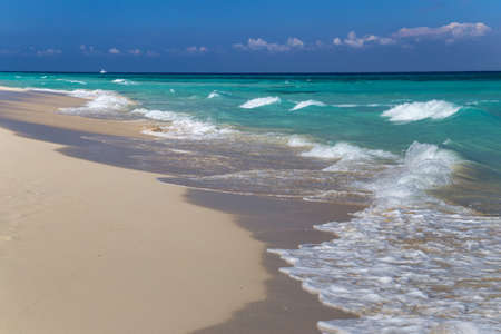 Soft wave on a white sand beach