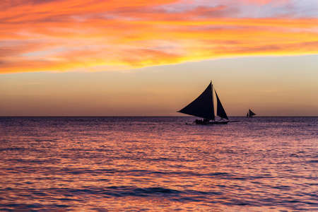 Small sailing boats at the sunset. Boracay, Philippines