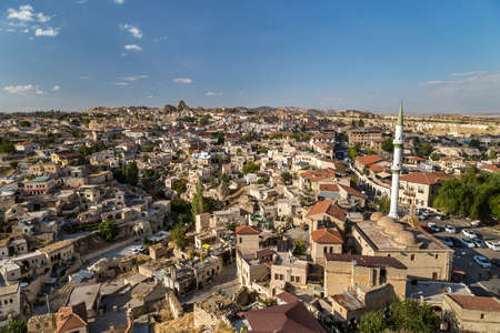 View to a town with a mosque. Ortahisar, Turkey 免版税图像