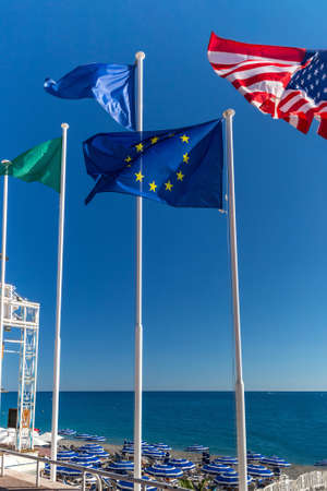 European and American flags on the background of the sky and the sea