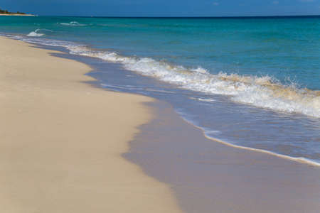Blue wave on a white sand tropical beach