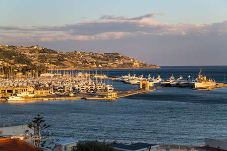 View to a city and a marina at the Mediterranean sea