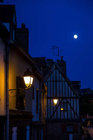 Night scene with the moon and lanterns. Old street in historical part of Amiens, France