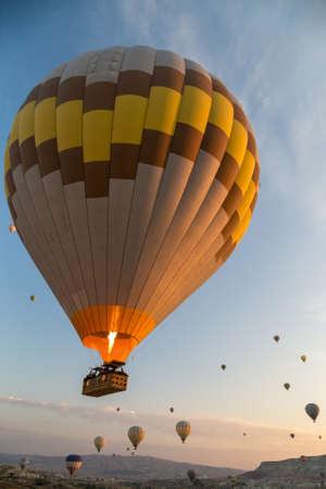 Hot air balloons flying at sunrise