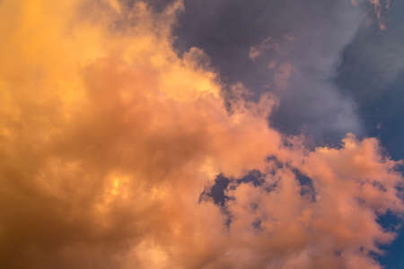 Dramatic clouds at colourful moody sunset 免版税图像