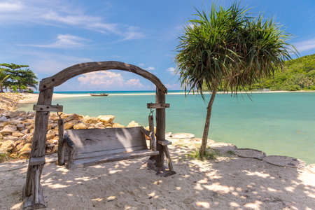 Wooden swinging bench on a beach. Thailand