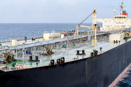 The oil tanker in the high sea after a rain