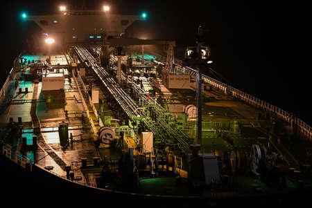The tanker in the high sea at night Standard-Bild