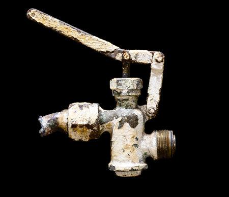 The old valve on a black background Standard-Bild