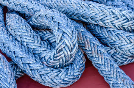 Nautical background. Closeup of an old frayed boat rope. Standard-Bild