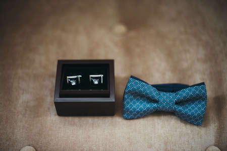 cuff link: cufflinks and blue tie