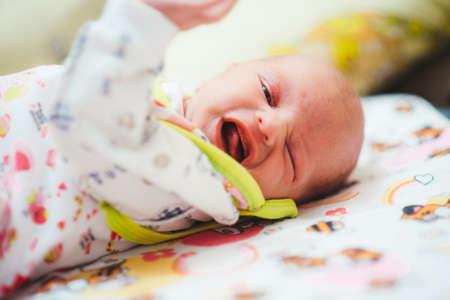 colic: harsh child at mum on hands