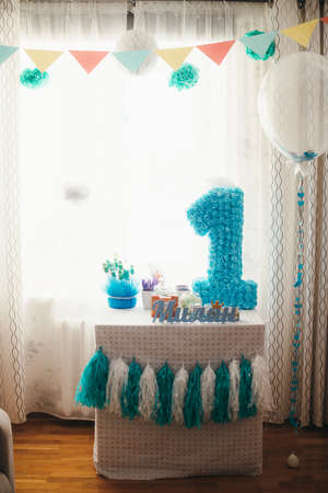 blue candy bar on a year old baby Stock Photo