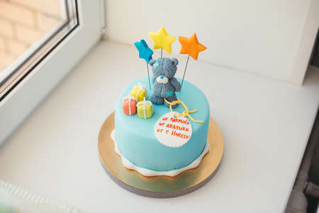 blue cake with a bear and stars Stock Photo
