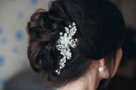 wedding hairstyle, Wedding dress. Wedding decoration. soft selective focus. gorgeous young bride at home. series.