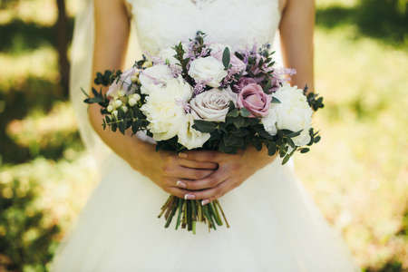 bride bouquet of purple flowersbridal bouquet of white roses and lilac