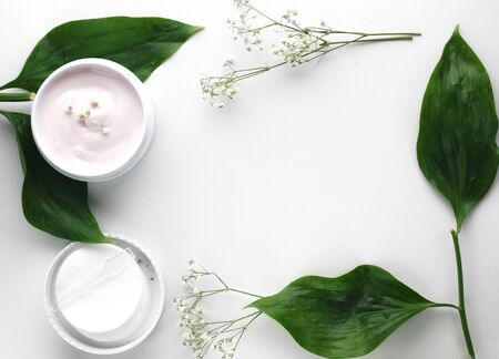 Organic skincare products on minimalistic background with copy space