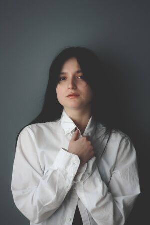 Home office. Attractive caucasian brunette girl at home, emotional portrait. Beautiful girl in shirt chilling. Sensual, free from standarts. How to be beauty while freelance, outsource working.