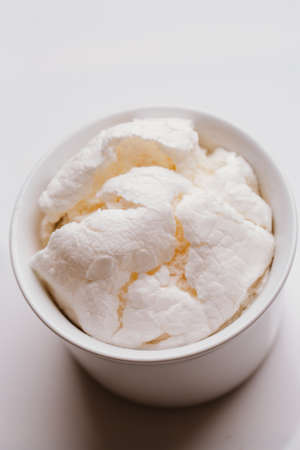 exquisiteness: Fresh meringue in light bowl on a white background.