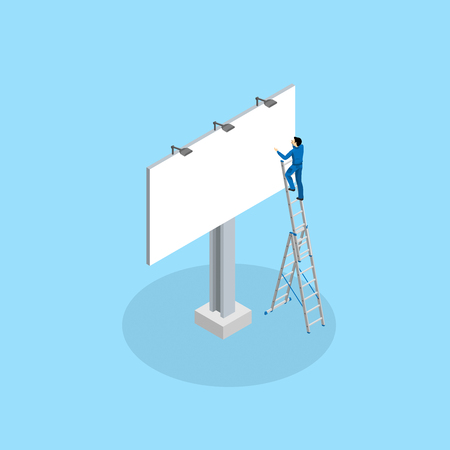 The advertising worker glues the billboard standing on the mounting ladder