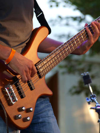 bass player: Bass player performing on a stage