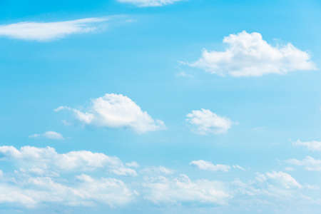 expanse: Clear blue sky with white fluffy clouds Stock Photo