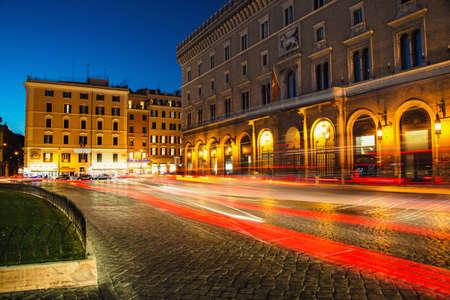 Venezia Palace Palazzo Venezia - the palace of Victor Emmanuel at the Venezia Square Piazza Venezia in Rome, Italy at night. Long exposure, car lights trails effect. Editorial