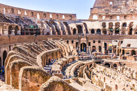 24: ROME, ITALY - APRIL 24, 2017. Inside view of The Colosseum with tourists sightseeing.