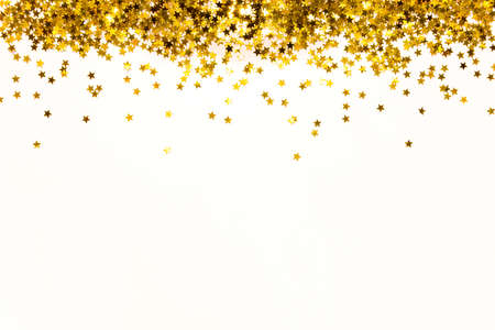 Star shaped golden sequins background. Copy space.